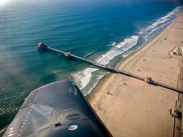 The biggest maneuver I make during our flight is a 360 degree turn around the tip of Huntington Beach Pier.  As we come around the point for a second time, I ask the instructor to take over so I can snap a couple of pictures.