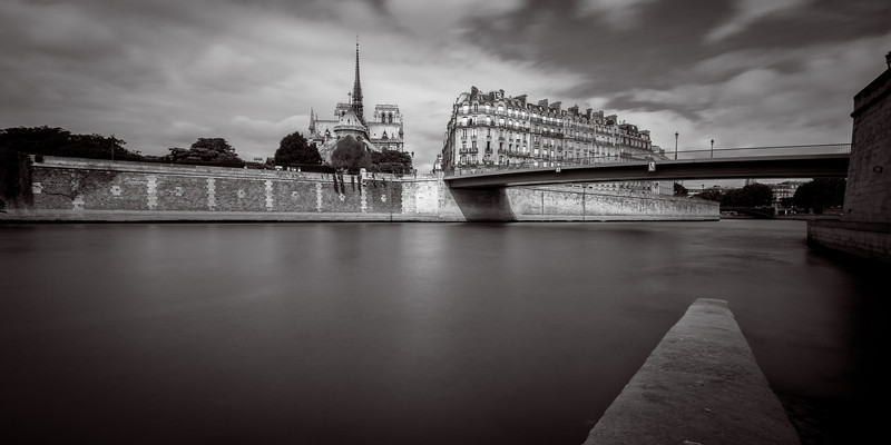 Pont St. Louis to Notre Dame<br /> <br /> Tech:<br /> Camera | Nikon D7100<br /> Lens | Nikkor 12-24mm; at 12mm<br /> Exposure | 10 sec; f/11; ISO 100<br /> Filters: B+W ND 110