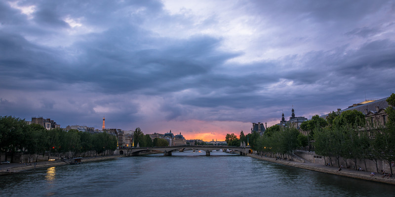 Sunset over La Seine<br /> <br /> Tech:<br /> Camera | Nikon D7100<br /> Lens | Nikkor 18-200mm; at 18mm<br /> Exposure | 1.3 sec; f/11; ISO 100<br /> Filters: None