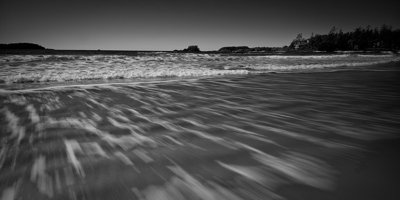 In the surf. Chesterman Beach.<br /> <br /> Tech:<br /> Camera | Nikon D80<br /> Lens | Nikkor 12-24mm<br /> Exposure | 0.25sec;  f/11; ISO 100<br /> Filters: Cokin ND8