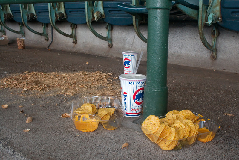 """An artistic shot I took on the way out of the stadium. Peggy thought I had lost my mind. I just thought this summarized the game story well... """"The Cubs got Trashed"""". :("""