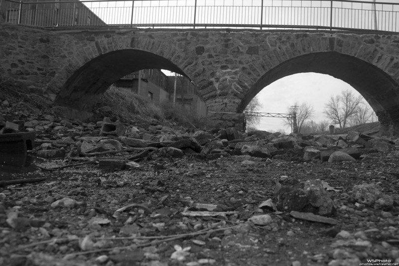 Empty Millrace 2<br /> <br /> Crawled down into the millrace while they had it emptied for construction of a pedestrian underpass. Thought black & white best reflected the mood of this shot.