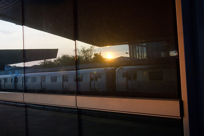 Reflecting on a train.