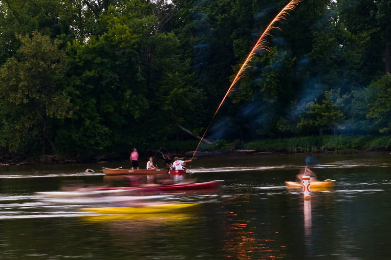 Title: Flaming Excited<br /> Date: 2011<br /> Some kayakers fire off fireworks next to Teddy Roosevelt Island on the Potomac.
