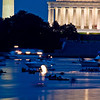 Title: Fire Water<br /> Date: 2009<br /> Boats along the Potomac River, with some lighting up fireworks on the water.