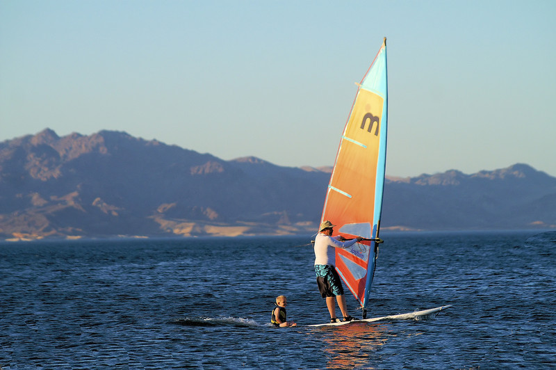 wind surfer and passenger