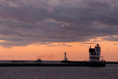30SEP09  A tug and a barge make their way outbound from the Port of Lorain at sunset. Brisk north winds might bring a chance of frost inland.   photo by Chuck Humel