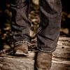 Cowboy boots on a log