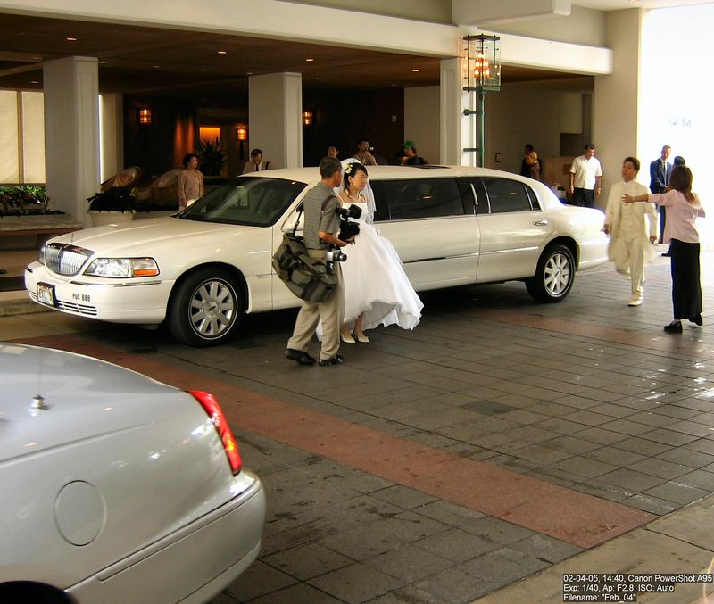 Happened upon the end of a wedding at one of the fancier hotels in Waikiki. Notice the groom is being hustled into place for a picture.