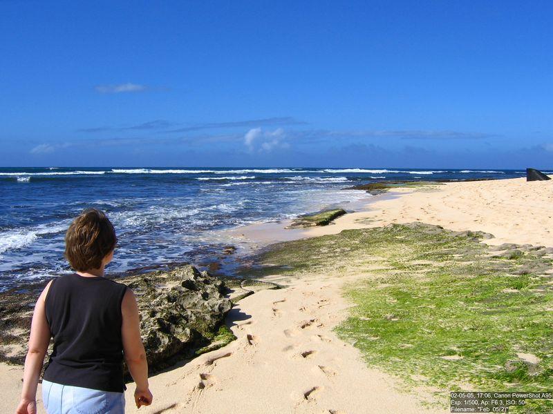 My wife walks on the beach at Sunset Beach, Oahu.