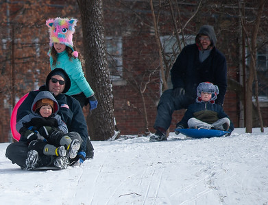 Family Fun On The Sledding Hill