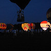 "2008 May 24:  The few balloons ""glowing"" at the Alabama Jubilee.  These are the best of what I got.  It was too windy earlier for any of them to actually fly.  :-("