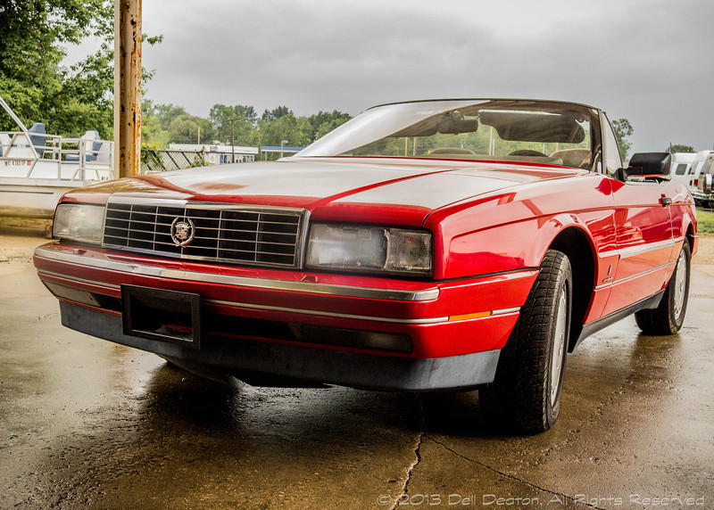 Red Cadillac Allante, from the 1991 model year.  Photographed using Leica X2 digital camera with Elmarit 24mm f/2.8 lens; APS-C sensor (23.6mm x 15.8mm), 16.2 megapixels; set to f/6.3 at 1/800-second exposure, ISO 800; daylight. Composed for 7 x 5 aspect ratio; raw to jpeg. Processed in Adobe Lightroom 4 and Photoshop Elements 10.  Photographic equipment: Norman Camera, Kalamazoo, Michigan  May 28, 2013