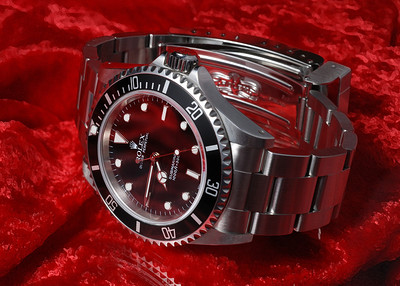 Rolex diver's watch, Oyster Perpetual Submariner reference 14060M model. Image is part of a sequence made in preparation to list it for sale.  Photographed using Nikon D80 digital camera with AF Micro-Nikkor 60mm f/2.8D lens: APS-C sensor (23.6mm x 15.8mm), 10.2 megapixels; set to f/3.2 at 1/60-second exposure, ISO 200; studio strobe lighting. Composed for 7 x 5 aspect ratio; jpeg. Processed in Adobe Photoshop Elements 10.   Select subject matter: Leo's Jewelers, Wayne, Michigan  April 28, 2008