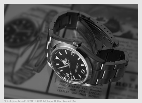 Rolex Explorer I, model 114270 wristwatch, on original vintage print advertisement from 1960s