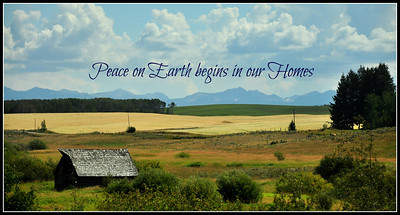 Peace on Earth Begins at Home. Barn and farmland near Ashton, Idaho with Teton Mountain Range in the background.