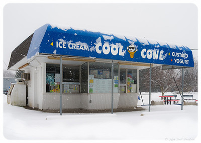 Cool Cone ice cream shop, near my office in Belleville, Michigan. Sort of an independent version of Dairy Queen, I guess. Taken in the midst of a persistent winter snowfall, with building closed for the season. Loved the contrast of product versus environment; at the same time, imagining how welcome this image would be in the heat of summer business, customers lined up for whatever cool they could get here.  Photographed using Leica X2 digital camera with Elmarit 24mm f/2.8 lens: APS-C sensor (23.6mm x 15.8mm), 16.2 megapixels; set to f/5.6 at 1/500-second exposure, ISO 100; daylight. Composed for 7 x 5 aspect ratio; raw to jpeg. Processed in Adobe Lightroom 4.  Photographic equipment: Norman Camera, Kalamazoo, Michigan  February 4, 2013