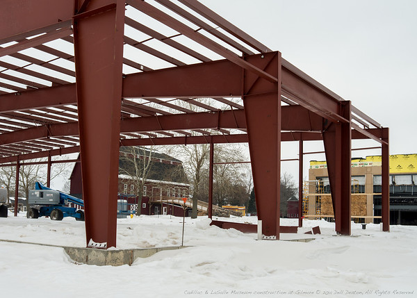 Locked in time: Looking out onto the Gilmore Car Museum campus, toward iconic Shell gas station, with one of the signature barn structures used to house automobile displays in view. Across and to the right, construction on the new Lincoln Museum. All of this framed by the newly-erected steel structure for Cadillac & LaSalle Club Museum and Research Center, scheduled to open June 2014.  Photographed using Leica X2 digital camera with Elmarit 24mm f/2.8 lens; APS-C sensor (23.6mm x 15.8mm), 16.2 megapixels; set to f/8 at 1/200-second exposure, ISO 100; daylight. Processed in Adobe Lightroom 4.  Photographic equipment: Norman Camera, Kalamazoo, Michigan  January 19, 2014