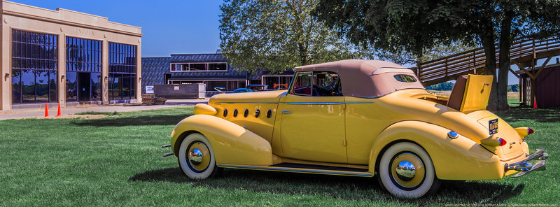 """This 1934 LaSalle convertible is """"officially"""" the fifth vehicle to appear before the Cadillac-LaSalle Club Museum and Research Center at Gilmore. I made this image in support of the social media campaign I've created and continue to manage on behalf of Museum construction.  Photographed using Leica X2 digital camera with Elmarit 24mm f/2.8 lens; APS-C sensor (23.6mm x 15.8mm), 16.2 megapixels; set to f/16 at 1/50-second, ISO 100; daylight. Non-standard cropping; raw to jpeg. Processed in Adobe Photoshop Elements 10.  Photographic equipment: Norman Camera, Kalamazoo, Michigan  Select subject matter: Robert A Lutz  June 1, 2014"""