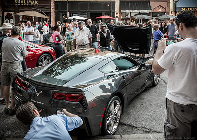 "New Chevrolet Corvette for 2014, as it appeared in downtown Ann Arbor, Michigan, at 2013 ""Rolling Sculpture Car Show.""  Photographed using Leica X2 digital camera with Elmarit 24mm f/2.8 lens; APS-C sensor (23.6mm x 15.8mm), 16.2 megapixels; set to f/5.6 at 1/50-second exposure, ISO 800; daylight. Composed for 7 x 5 aspect ratio; raw to jpeg. Processed in Adobe Lightroom 4.  Photographic equipment: Norman Camera, Kalamazoo, Michigan  July 12, 2013"
