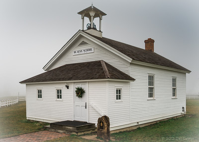 """According to the Saline Historical Society, this """"Weber-Blaess one-room school was built in 1867 in Section 17, on Ellsworth Road in Lodi Township,"""" Michigan. Moved to its present location on what I guess could be called the contemporary elementary and middle school """"campus"""" on June 19, 2002. Thus my choice of this very foggy day to make the schoolhouse photo above: Isolating Weber-Blaess from those otherwise obvious environs, making for a presentation more akin to the period when classes were actually held here.  Photographed using Leica X2 digital camera with Elmarit 24mm f/2.8 lens: APS-C sensor (23.6mm x 15.8mm), 16.2 megapixels; set to f/2.8 at 1/500-second exposure, ISO 200; daylight. Composed for 7 x 5 aspect ratio; raw to jpeg. Processed in Adobe Lightroom 4.  Photographic equipment: Norman Camera, Kalamazoo, Michigan  December 3, 2012"""