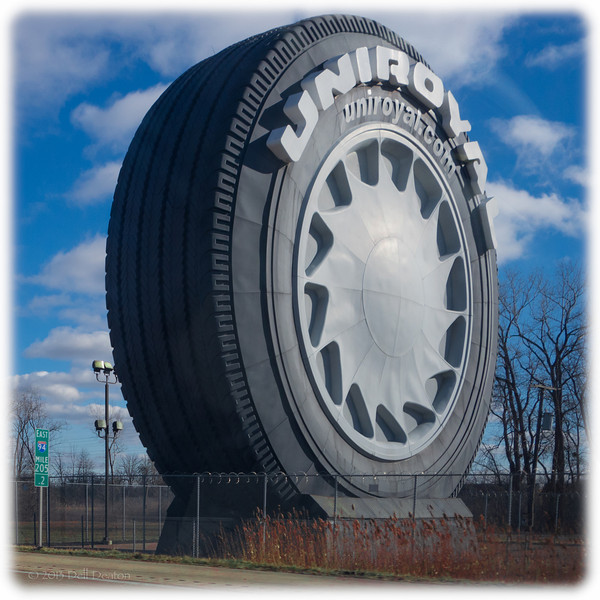 "Uniroyal ® ""Giant Tire"" marketing icon, next to eastbound I-94 in Allen Park, Michigan (past Metro Airport, just outside Detroit). The original Uniroyal Giant Tire was a ferris wheel created for the 1964-1965 New York World's Fair. the Uniroyal Giant Tire shown here is the fourth iteration, Mark IV, I guess: The result of an ~$1.0 million renovation effort undertaken in 2003.  Photographed using Sony RX100 digital camera: 1"" sensor (13.2mm x 8.8mm), 20.9 megapixels; set to f/5.6 at 1/500-second exposure, ISO 125; daylight. Composed for 1 x 1 square aspect ratio; raw to jpeg. Processed in Adobe Lightroom 4.  Photographic equipment: Woodward Camera, Birmingham, Michigan  January 20, 2013"