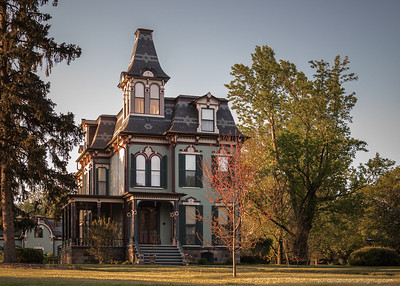 """Davinport-Curtiss House, Saline, Michigan. I've always known it as """"The Curtiss Mansion."""" Built by William Davenport, circa 1876; passed on to Carl Curtiss in 1930. Faces US-12, a/k/a Michigan Avenue.  Photographed using Leica X2 digital camera with Elmarit 24mm f/2.8 lens: APS-C sensor (23.6mm x 15.8mm), 16.2 megapixels; set to f/4 at 1/500-second exposure, ISO 200; daylight. Composed for 7 x 5 aspect ratio; raw to jpeg. Processed in Adobe Lightroom 4.  Photographic equipment: Norman Camera, Kalamazoo, Michigan  May 16, 2013"""