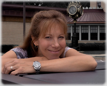 "Janet, in front of the National Watch & Clock Museum, Columbia, Pennsylvania. There to decommission ""Ian Fleming's Own James Bond Watch"" display. Wearing Rolex reference 115200 Oyster Perpetual Date wristwatch (specified by author Jeffery Deaver in his novel Carte Blanche as James Bond's personal watch choice).  Photographed using Nikon D7000 digital camera with AF-S Nikkor 18-55 f/3.5-5.6 G DX VR lens; APS-C sensor (23.6 x 15.7), 16.2 megapixels; set to f/16 at 1/250-second exposure, ISO 400; on-camera flash and daylight. Composed for 10 x 8 aspect ratio; jpeg. Processed in Lightroom 4.  Select subject matter: Rottermond Jewelers, Brighton, Michigan  Photographic equipment: Huron Camera, Dexter, Michigan  July 22, 2012"