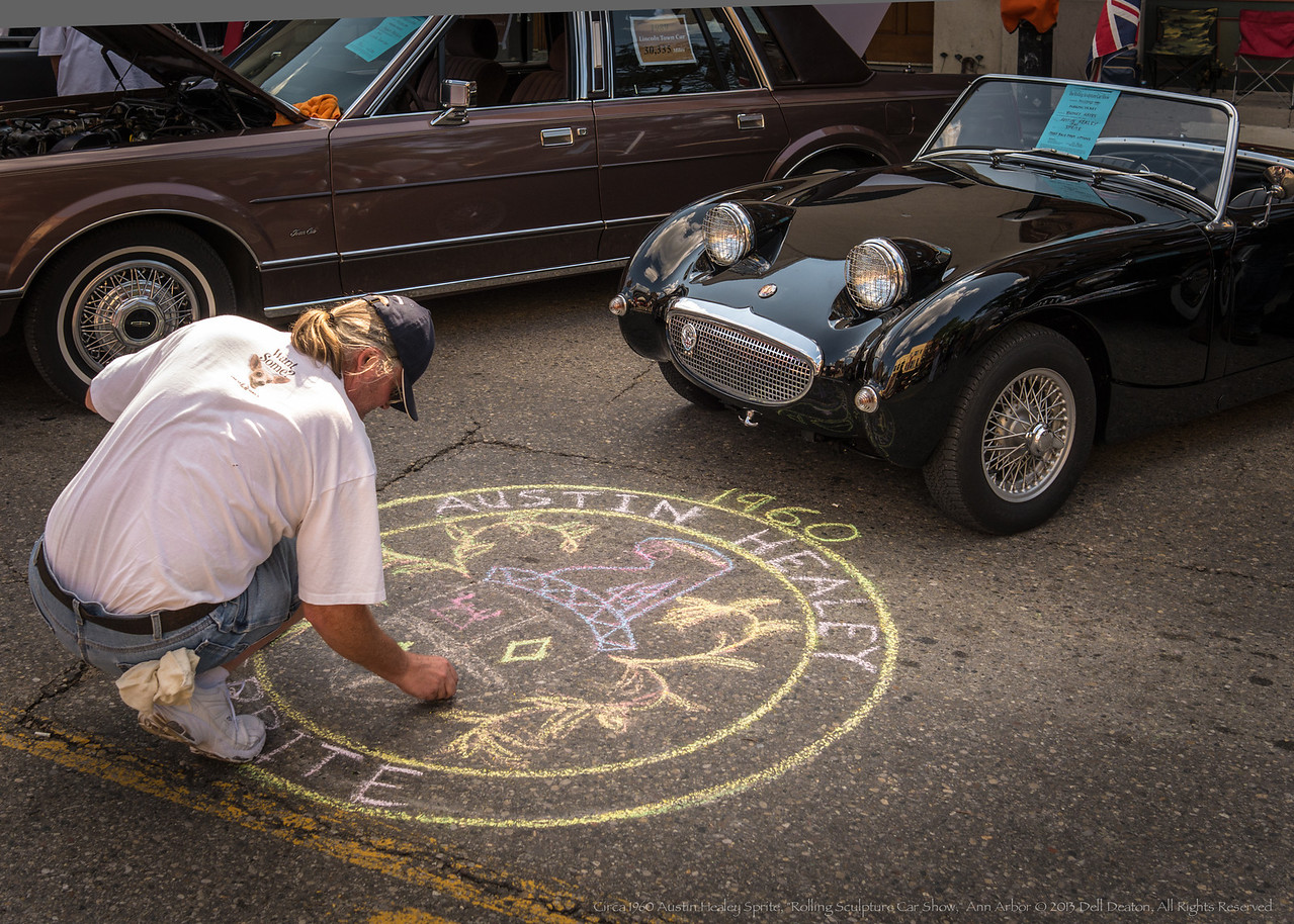 "Happened upon this rather interesting goings-on at the 2013 ""Rolling Sculpture Car"" show in Ann Arbor, Michigan. Nice mix of a fellow obviously enamored of his 1960 Austin Healey Sprite, given a bit of talent, making somewhat of a different presentation.  Photographed using Leica X2 digital camera with Elmarit 24mm f/2.8 lens; APS-C sensor (23.6mm x 15.8mm), 16.2 megapixels; set to f/5.0 at 1/640-second exposure, ISO 200; daylight. Composed for 7 x 5 aspect ratio; raw to jpeg. Processed in Adobe Lightroom 4.  Photographic equipment: Norman Camera, Kalamazoo, Michigan  July 12, 2013"