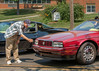 Photographer focused on headlight washer fluid port on 1993 Cadillac Allante at 2014 Saline Street Machines car show