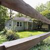 Split rail fence & house