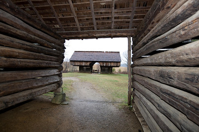 Cantilever barn through nearby corn crib   Cades Cove GSMNP  Jan 2009