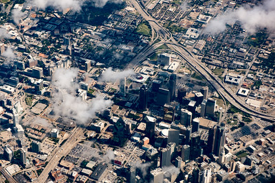 Downtown Dallas. Note severe localized distortion in aircraft window. Looking nearly straight down at bottom of window.