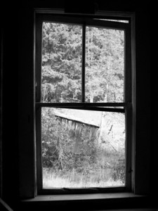 "Window  to the Past:  The view from the window of a home in Garnet Ghost town, Montana.  ""Of all the memorable views, the best have been framed by Montana windows."" -- The View from My Window, William Hjortsberg"