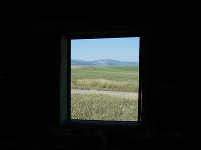 Mountain view through window of old Idaho homestead
