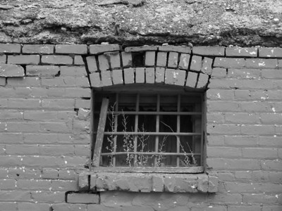 Old West jail cell window.  Baker, Montana.  Original town jail circa 1909