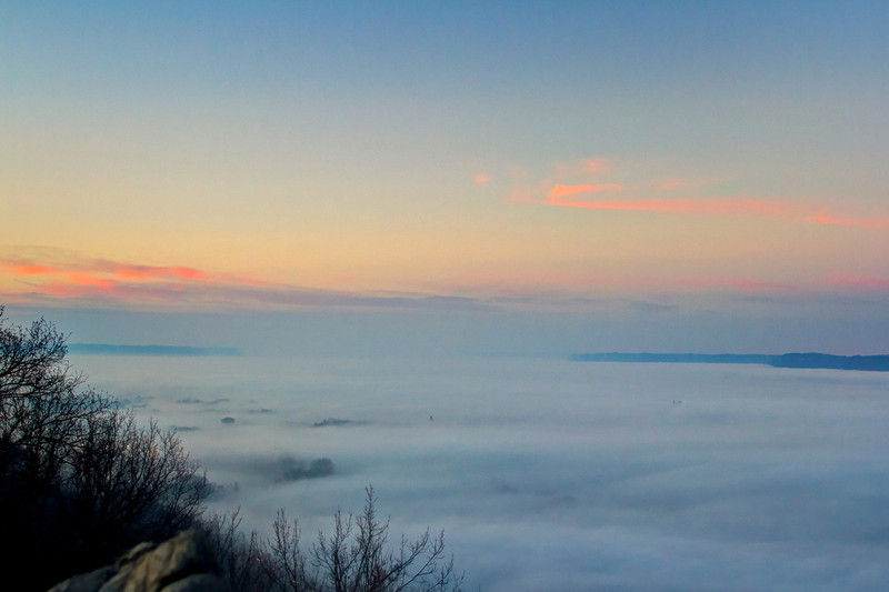 Low hanging fog covering up the entire Mississippi River Valley.