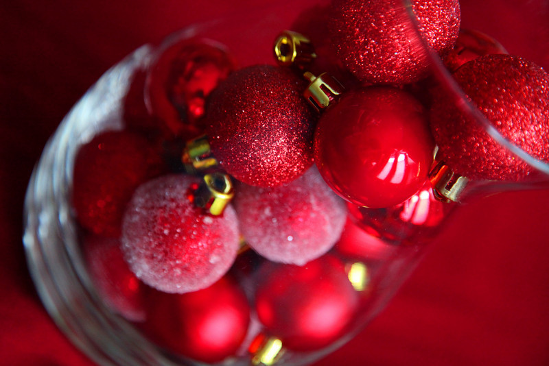 glass container of christmas ornaments