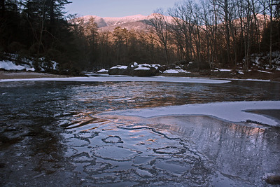 Ice in the South Toe River with the Black Mountains in the distance