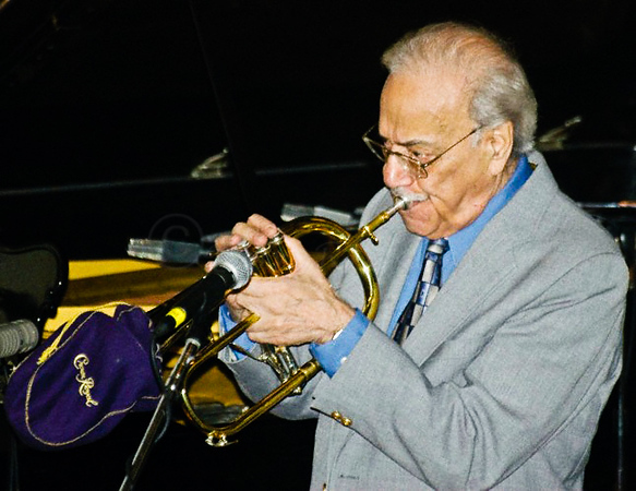 "Emil Haddad at Tuckerman Hall, Worcester MA, playing his Flugal Horn with his favotite ""Mute"", a Crown Royal bag. ""Mr Huggable"" at his best!"