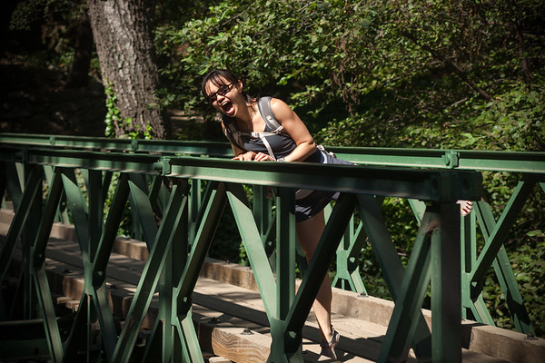 Valerie on a bridge being silly