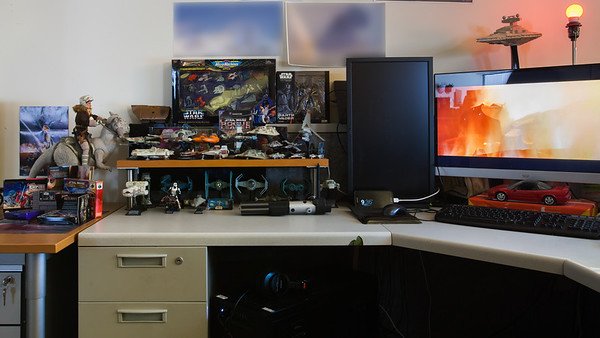 I brought some old toys and games I had been storing in my attic to decorate my workspace in time for a Star Wars-themed holiday office party...so themed because it culminates with a screening of Star Wars Episode 7: The Force Awakens (the games on the other desk belong to Ryan, but my toys are spilling over)