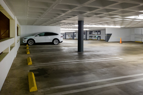 More color accents are being added to columns and walls within the parking structure