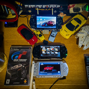 "But the lack of a true Simulation Mode, rate of collecting marred by a bizzare random rotation of car dealerships, races limited to only four vehicles (and multiplayer limited to head-to-head)...this PSP iteration definitely failed to live up to Sony's E3 claim that it would be ""in no way inferior to its console counterpart"""
