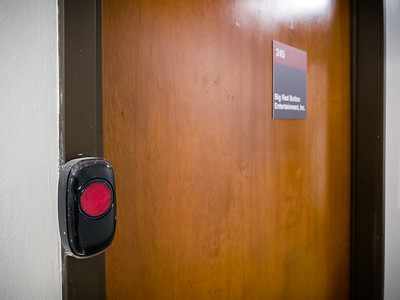 I wish our studio's big red doorbell looked more legit