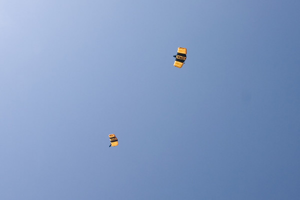 As I walk to the Convention Center, I hear a helicopter overhead.  When I look up, I see people jumping out.  By the time I get my camera ready, a couple of parachutes have opened...