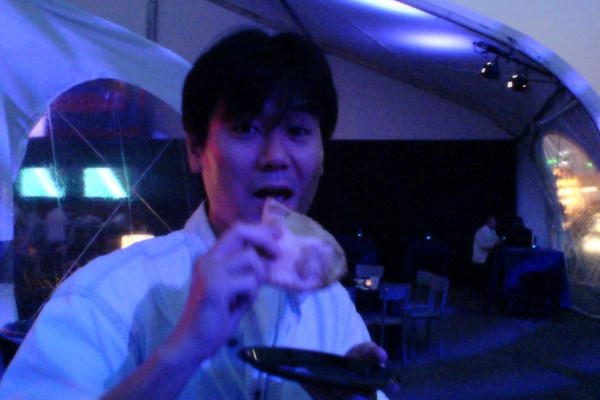 Yasuhara-san chows down a slice of pizza