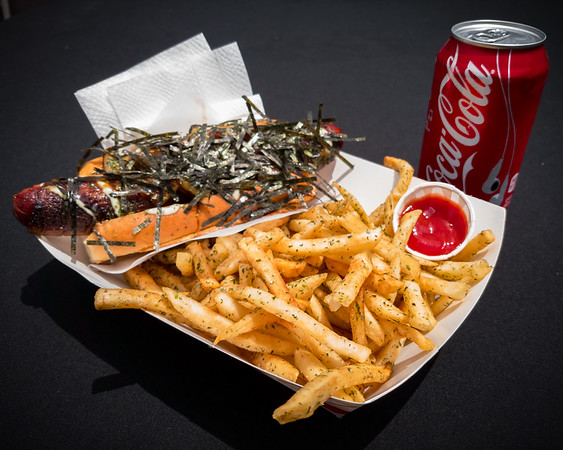 I grab lunch a Bacon Wrapped Hawaiian Terrier-ki Dog with Aonori Umami Dust Fries and a Coke from the Tokyo Doggie Style Truck