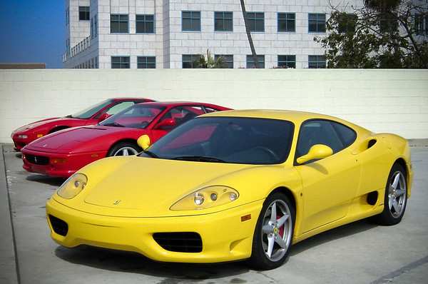 Mark's 1999 Ferrari 360 Modena and Jason's Ferrari 355 GTS provide top dollar door-ding protection for my Acura NSX-T.  On the downside, our exotic car corner tends to draw a lot of unwanted attention from tourists visiting the Promenade.
