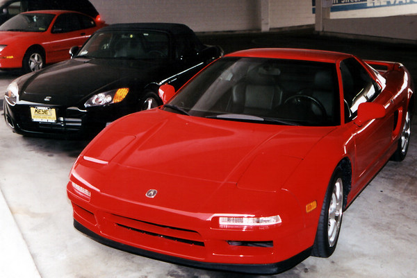 Don's 2001 black/black Honda S2000 and my 2000 NSX-T.  Unfortunately, we don't always get to park our cars next to each other  (March, 2001)